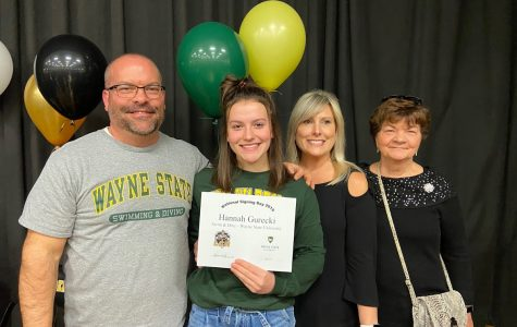 Gurecki celebrating the continuation of her swimming career with her family.