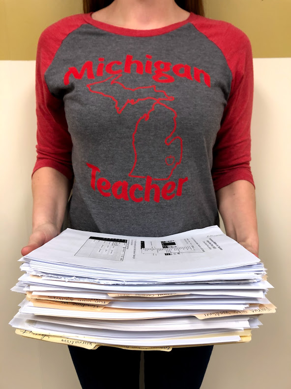 A Michigan Teacher shows off one and a half weeks worth of work in paper for one class.