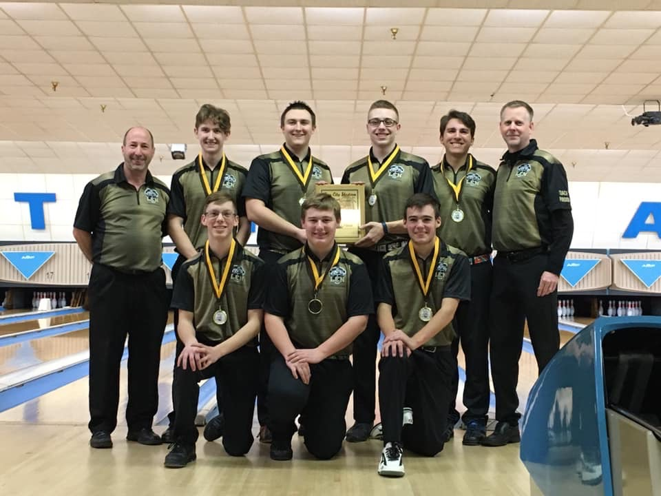 The boys bowling team after winning first place in the Bakers Dozen tournament.