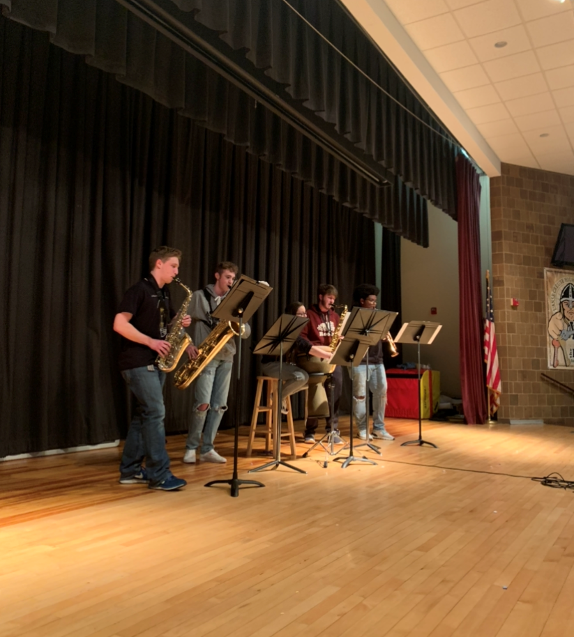 The band, Strange Humors, with students Kylie Bedard, '20, Tyler Fici, '20, Raymond  Loyal, '20, Tyler Reese, '20, and Christian  Williams, '21 performs their piece that they planned to perform at States.