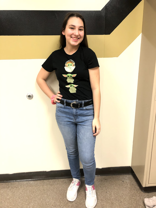 Olivia+Briggs%2C+%2722+poses+in+her+Baby+Yoda+shirt.