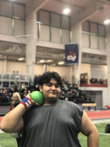 Kamuran Ramadanov at Saginaw Valley State University after throwing the shot put his official best of 27
