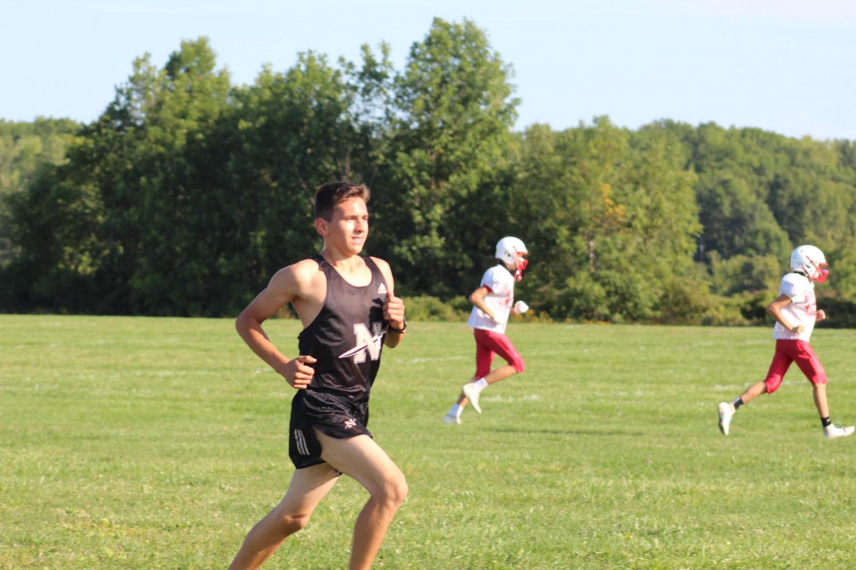 Brandon Penberthy racing a Cross-Country race at Anchor Bay High School during early september. Photo credit, Sara Krug.