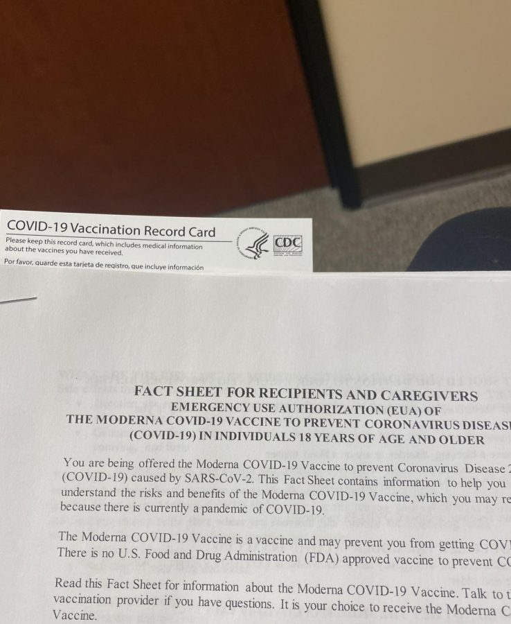 This is a packet of information given to you as you wait to receive the vaccine.  Photo Credit, Reese Cook