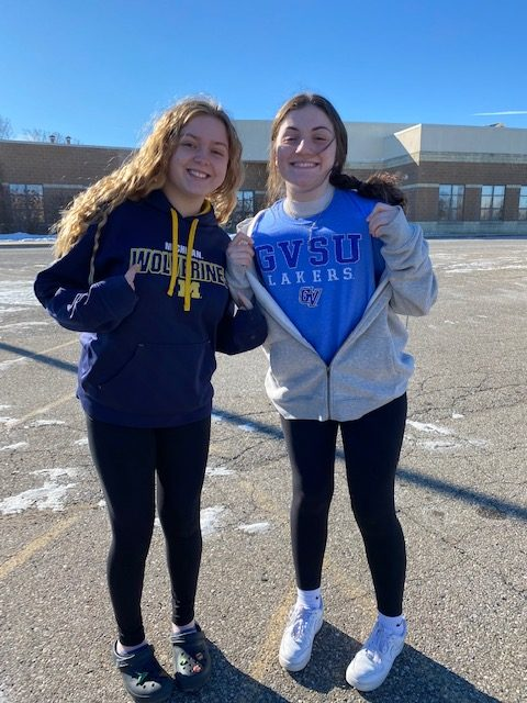 Seniors Mia Cichowlas and Brianne Lowe dress up for the college gear theme.
