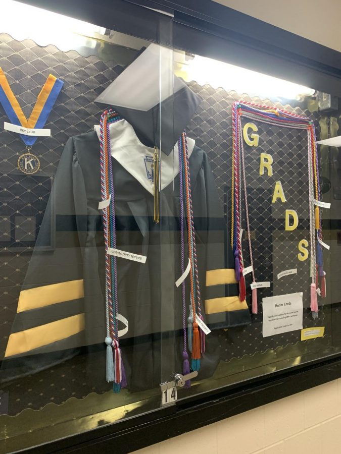 Graduation gown on display for seniors.