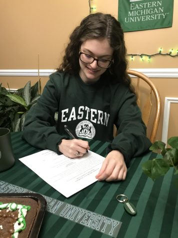 A photo as I signed my contract to commit to Eastern.